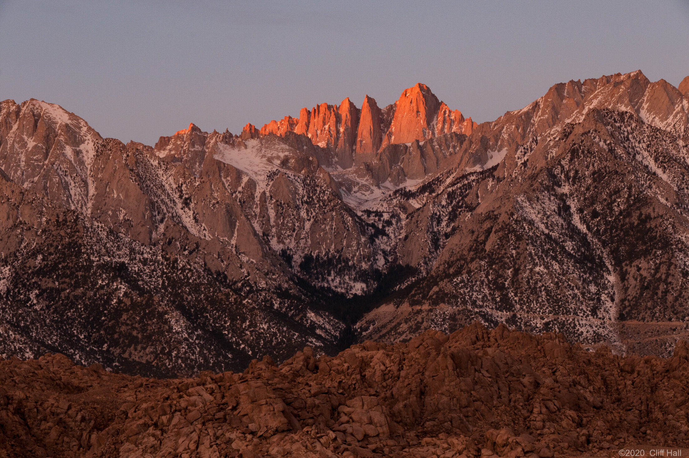 Mt Whitney is the right most peak with sunlight hitting it.