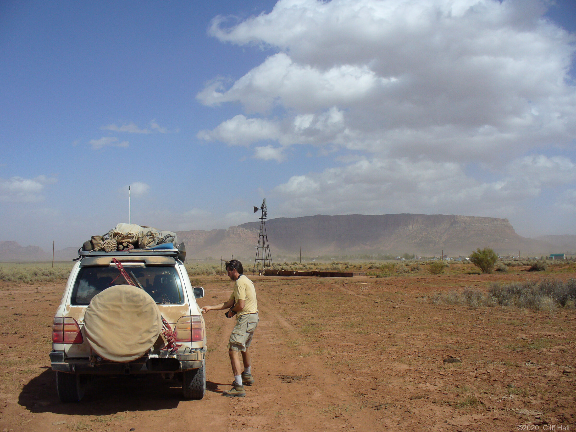 Steve in the blowing wind and a packed and dusty Land Cruiser