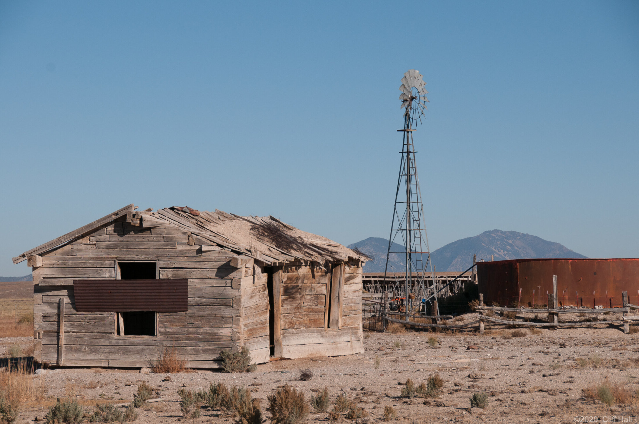 Abandoned buildings, but windmill still works
