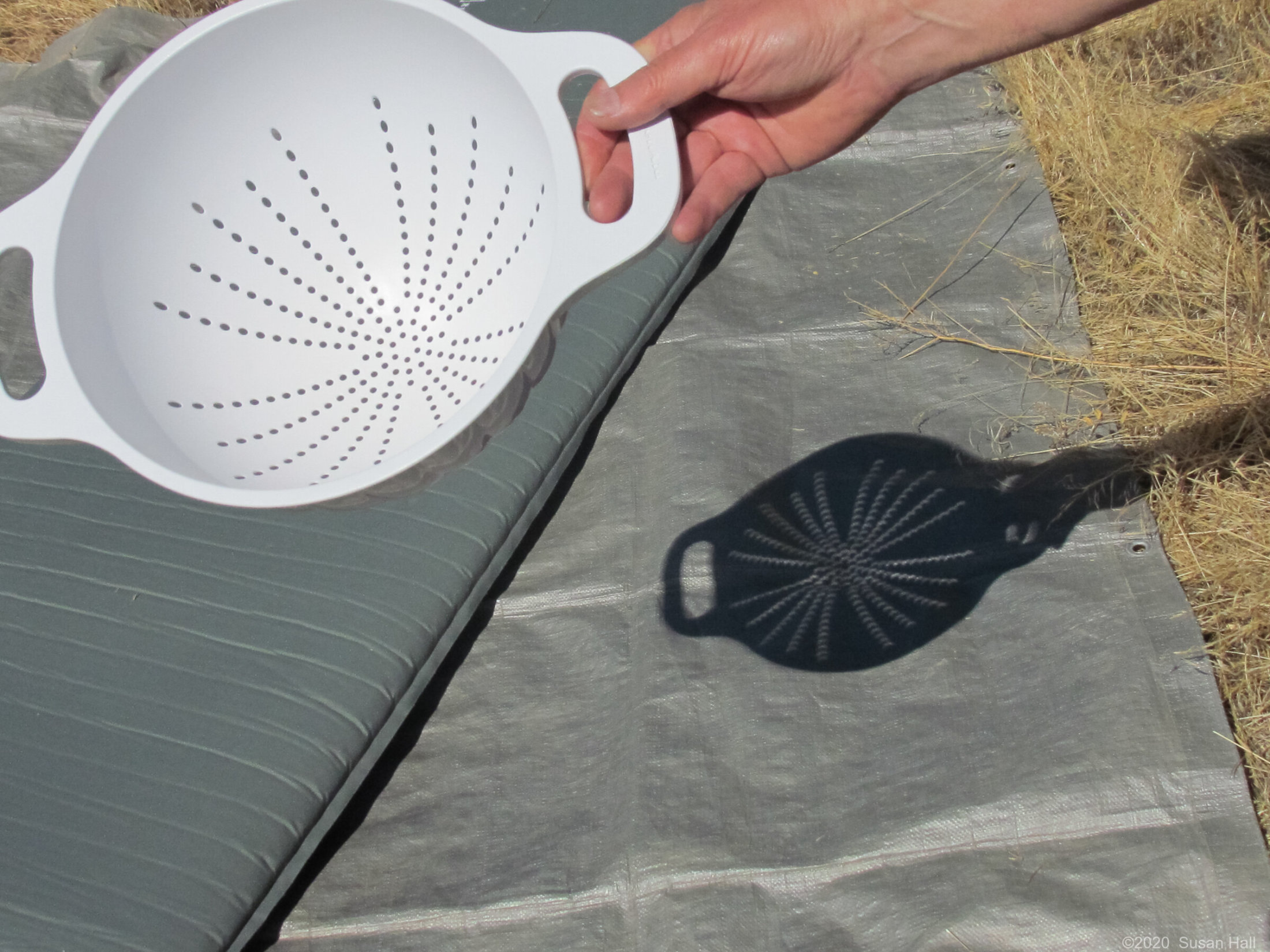 Holes make crescent shaped shadows