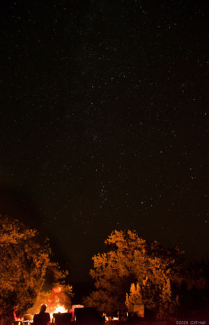 Camp fire under a starry night
