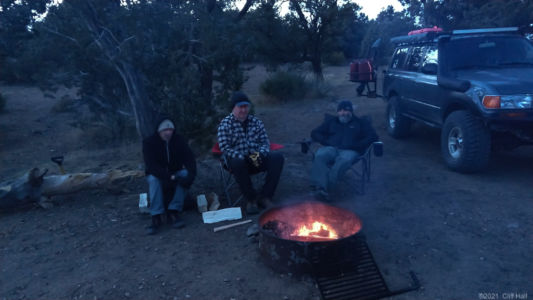 Duc, Don and Ben warm up by the fire