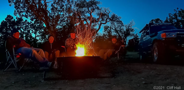 Cliff, Duc, Don and Ben have a good fire going